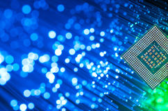 Processor Chip On Fiber Optics. Computer Processor Chip On Fiber Optics Background stock photos