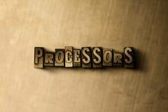 PROCESSORER - närbild av det typsatta ordet för grungy tappning på metallbakgrunden Royaltyfri Foto