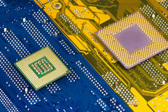 Processors On Motherboard Background. Closeup stock photography