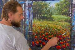 Processus créatif d'art L'artiste créent la peinture sur la toile photo stock