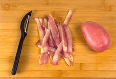 Processus de faire cuire des pommes frites Images libres de droits