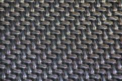 Processus en plastique noir de modèle de vannerie de tisser ou de coudre les matériaux flexibles image libre de droits