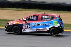 Prochevy sonic-raceauto op de cursus Stock Afbeelding