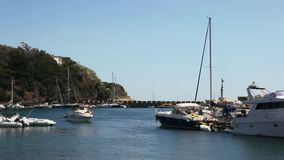 Procida, boats moored in the Marina of Chiaiolella. stock footage