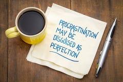 A procrastinação pode ser disfarçada como a perfeição fotografia de stock