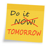 Procrastination - do it now or tomorrow sticky note Royalty Free Stock Photography