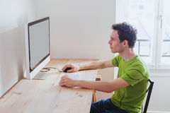 Procrastination. Man in front of computer at home, procrastination Stock Photo