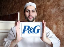 Procter & Gamble , P&G company logo. Logo of Procter & Gamble , P&G company on samsung tablet holded by arab muslim man. P&G is an American consumer goods Royalty Free Stock Photography