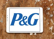 Procter & Gamble , P&G company logo. Logo of Procter & Gamble , P&G company on samsung tablet on wooden background. P&G is an American consumer goods corporation Stock Photos