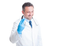 Proctologist showing two fingers with surgical latex gloves. Smiling isolated on white background Royalty Free Stock Photography