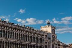 Procuratie Vecchie's arcades and Torre dell'Orologio in Saint Ma Stock Photography