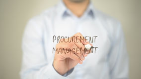 Procurement Management  , man writing on transparent screen. High quality Royalty Free Stock Photo