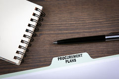 Procurement Plans Concept.  Folder Register on a dark wooden desk Stock Photo