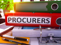 Procurers on Red Office Folder. Toned Image. 3D. Stock Photography