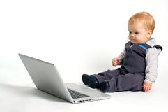 Prodigy baby. Blond baby in suit working with laptop Royalty Free Stock Photography