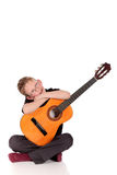 Prodigy Boy acoustic guitar. Young prodigy boy with acoustic guitar.  Studio, white background Stock Image