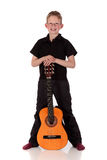 Prodigy Boy acoustic guitar. Young prodigy boy with acoustic guitar.  Studio, white background Stock Photo
