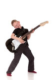 Prodigy Boy electric guitar. Young prodigy boy with electric guitar.  Studio, white background Royalty Free Stock Image