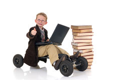 Prodigy internet library surfing. Handsome young child, prodigy, high speed surfing to internet library, metaphor with skateboard, studio shot Stock Images