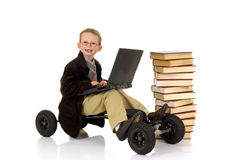 Prodigy internet library surfing. Handsome young child, prodigy, high speed surfing to internet library, metaphor with skateboard, studio shot Royalty Free Stock Images