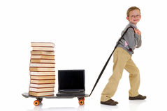 Prodigy internet library surfing. Handsome young child, prodigy, high speed surfing to internet library, metaphor with skateboard, studio shot Stock Photography