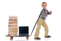 Prodigy internet library surfing. Handsome young child, prodigy, high speed surfing to internet library, metaphor with skateboard, studio shot Royalty Free Stock Photo