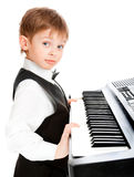 Prodigy pianist. Little prodigy pianist looking at the camera Stock Photos