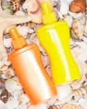 Prodotti cosmetici della protezione solare per cura di pelle Fotografia Stock Libera da Diritti