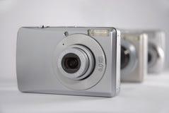Prodotti elettronici di consumo: Macchine fotografiche Immagini Stock Libere da Diritti