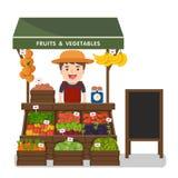 Prodotti locali delle verdure di vendite di esercenti del mercato Fotografia Stock