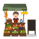 Prodotti locali delle verdure di vendite di esercenti del mercato Immagini Stock Libere da Diritti