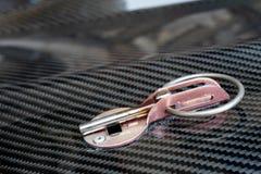 Prodotto automobilistico della parte fare dal composto della fibra del carbonio fotografie stock