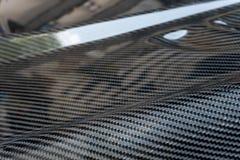 Prodotto automobilistico della parte fare dal composto della fibra del carbonio immagini stock