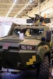 Producción de los vehículos ligeros blindados de KrAZ en la exposición especializada fotos de archivo libres de regalías