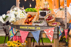 Produce bazaar, made of artificial fruit and vegetables. Produce bazaar, decoration made of artificial fruit, vegetable and flowers Stock Photo