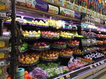 Produce display in grocery store royalty free stock photo