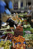 Produce on a farmers market. Colourful view down the counter of a stall laden with a variety of fresh fruit and vegetables at a farmers market with selective Stock Image