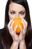 Produce - fruit  woman with orange Royalty Free Stock Photos