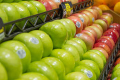 Produce: Granny Smith Apples in Foreground. Pasadena, California/USA - December 29 2015: Granny Smith apples in produce section at grocery store Stock Photo
