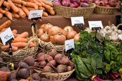 Produce at Local Farmers Market. Beets, onions, garlic, and carrots at a local farmers market Stock Photo