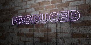 PRODUCED - Glowing Neon Sign on stonework wall - 3D rendered royalty free stock illustration. Can be used for online banner ads and direct mailers Royalty Free Stock Photo