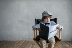 Producer. Little child with a screenplay in studio Stock Photos