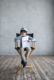 Producer. Little director with a screenplay Stock Photos