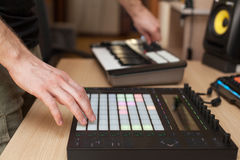 Producer makes a music on professional production controller with push button pads. Producer makes a music on professional production controller with push stock photography