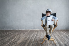 Producer with a screenplay. Boy with a screenplay in studio Stock Photography