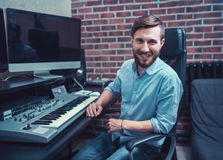 Producer. Smiling producer in recording studio royalty free stock photos