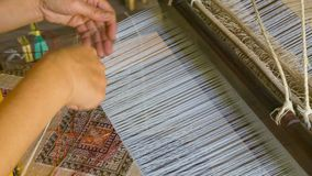 Producing fabrics with pattern - old traditional way stock video footage