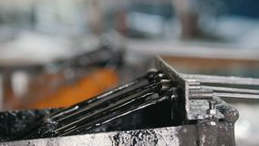 Producing of fiberglass reinforcement - the wire passes through the engine oil. Close up stock video footage