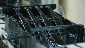 Producing of fiberglass reinforcement - the wire passes through the engine oil - top view. Shot stock footage