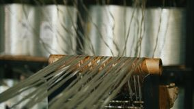 Producing fiberglass rods - manufacture of composite reinforcement, industry for construction. Close up stock footage